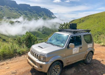 Travelling Sani Pass in 4x4 rental - Suzuki Jimny on top of Sani Pass. Photo courtesy of Frank van Rosmelan